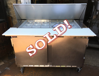 """Elite Series™ Mega Top Refrigerated Counter, two-section, 48"""" W, 13.9 cu. ft., (2) doors, stainless steel top with opening for (18) 1/6 size pans, 10"""" cutting board, stainless steel exterior, aluminum interior, rear-mounted self-contained refrigeration, (pans furnished are 4"""" deep, tops will accommodate 6"""" deep pans) 6"""" casters, 1/4 HP, UL, cUL, UL EPH, NSF, MADE IN USA"""