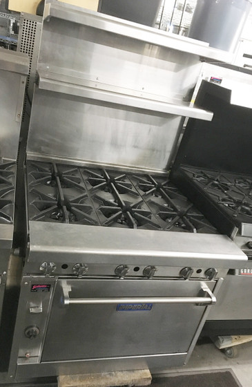 "IMPERIAL IHR-6 Diamond Series Heavy Duty Range, gas, 36"", (6) open burners, wavy cast iron grates, standard oven, (1) chrome rack, removable crumb tray, stainless steel front, sides, landing ledge, backguard & kick plate, 6"" legs, adjustable feet, 250,000 BTU, cETLus, ETL, NSF. Double shelf back.  Front gas manifold.  LP GAS"