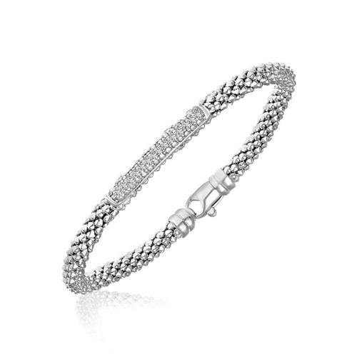 Sterling Silver Rhodium Finished Diamond Accented Popcorn Bangle (.14ct tw)