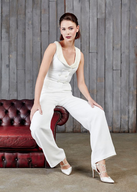 A modern day bridal jumpsuit for the modern day bride. The same bodice and waistcoat design as the original Laird, with wide legs, relaxed pockets and the same soft neckline but this time a gold and ivory tweed adorns the lapels for a more wintery wedding theme.