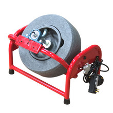 "DM150 Pivot Drain Cleaning Machine shown in locked in third position with 14"" polyethylene reel"
