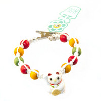 HOTI Hemp Handmade White Fortune Cat Maneki-Neko Peruvian Porcelain White Hemp Yellow Wood Beads Red Wood Beads Green Wood Beads Beckoning Cat Lucky Cat Good Luck Cat Ladies Womens Bracelet Hand Crafted Made in Toronto Made in Ontario Made in Canada Boho Tattoo Rocker Beaded Crow Beads Alligator Clip Roach Clip Clip It Clip