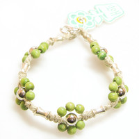 HOTI Hemp Handmade Natural Hemp Maria Signature Flower Power Anklet Green Silver Metal Beads Tube Dog Bone Beaded Flowers Floral Ladies Womens Ankle Bracelet Hand Crafted Made in Canada Made in Toronto Made in Ontario Boho Chic Clasp-It Lobster Clasp Toronto Ontario Canada