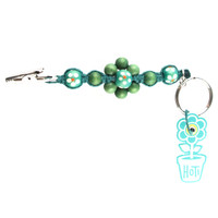 HOTI Hemp Handmade Green Hemp Flower Power Keychain Floral Beaded Roach Clip Key Chain Wood Round Painted White Orange Flowers Beads Signature Made in Canada Hand Crafted Made in Toronto Made in Ontario 420 Marijuana Cannabis Clip-It Mini Metal Alligator Clip Split Ring Canadian Clip Toronto Ontario Canada