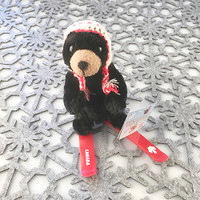 "Stuffed Animal House 6"" Black Bear Canada Wildlife Wild Skiing Canadian Pilot Knit Hat Red Plastic Skis Embroidered White Printed Maple Leaf Ski Plush Toy"