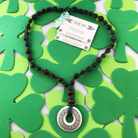 HOTI Hemp Handmade Knotwork Celtic Art Annulus Porcelain Knot Pendant Donut Brown Wood Bead Green Hemp Beaded Ladies Women's Collection Knotted Necklace Y Shaped Touchstone Pottery Spiral Twisted Hand Crafted Made in Toronto Made in Ontario Made in Canada Boho Chic Beaded Toronto Ontario Canada Canadian Made