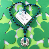 HOTI Hemp Handmade Dolphins Nehalennia Celtic Art Annulus Porcelain Dolphin Travelers Pendant Donut Black Wood Beads Turquoise Hemp Beaded Ladies Women's Collection Knotted Round Bead Necklace Y Shaped Touchstone Pottery Spiral Twisted Hand Crafted Made in Toronto Made in Ontario Made in Canada Boho Chic Beaded Toronto Ontario Canada Canadian Made