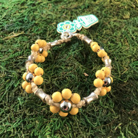 HOTI Hemp Handmade Beige Natural Hemp Maria Signature Flower Power Anklet Mellow Yellow Light Pale Wood Silver Metal Beads Tube Dog Bone Beaded Flowers Floral Ladies Women's Woman Ankle Bracelet Hand Crafted Made in Canada Made in Toronto Made in Ontario Boho Chic Clasp-It Lobster Clasp Toronto Ontario Canada Canadian