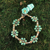 HOTI Hemp Handmade Beige Natural Hemp Maria Signature Flower Power Anklet Turquoise Blue Painted Yellow White Wood Silver Metal Beads Tube Dog Bone Beaded Flowers Floral Ladies Women's Jewellery Woman Girls Ankle Bracelet Hand Crafted Made in Canada Made in Toronto Made in Ontario Boho Chic Clasp-It Lobster Claw Clasp Toronto Ontario Canada Canadian Jewelry