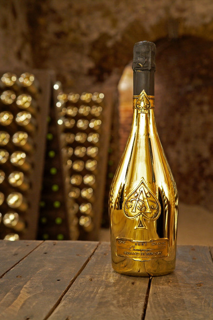 Colloquially Ace of Spades after the logo, is the name of a Champagne brand produced by Champagne Cattier, and sold in opaque metallic bottles. The brand's first bottling, Armand de Brignac Brut Gold, is identifiable by its distinctive gold bottle with pewter Ace of Spades labels.