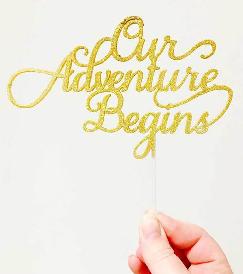 acrylic-wedding-cake-topper-our-adventure-begins.jpg