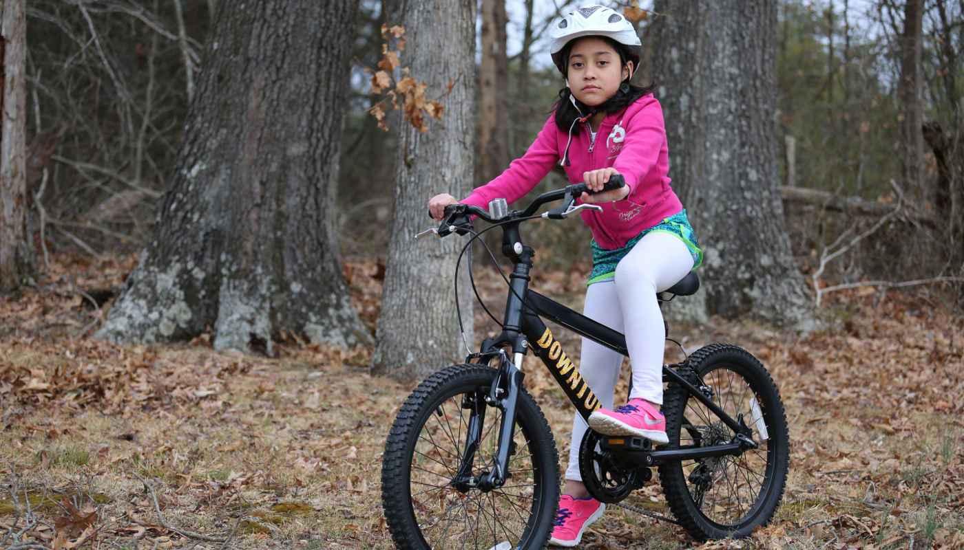 Race kids mountain bike with girl