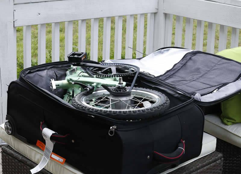 mini bike folded in suitcase