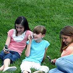 kids-useing-cell-phones-protected-by-tachyon.jpg