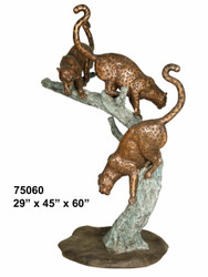 Leopards Climbing Down a Branch