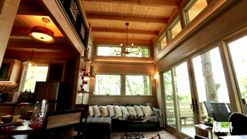 Frank Lloyd Wright inspired tree house featuring a Taliesin 3 table lamp full room view