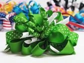 Bright green twirl polka dot hair bow w french clip
