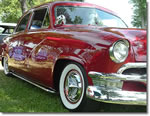 Fiesta Wheel Cover Hubcaps on a Vintage Red Chevy