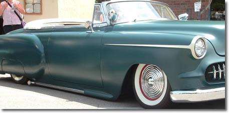 Ripple Discs Wheel Covers Starburst Hubcaps on a Sweet Lowrider