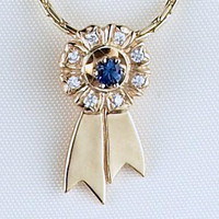 14k Gold Ribbon Pendant with Diamonds and Sapphire