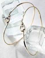 14k Gold Tiny Stirrup Bangle Bracelet with Center Diamond.