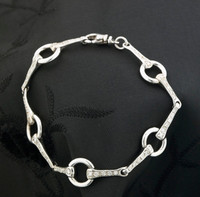 14k white gold and diamond loose ring snaffle bit bracelet