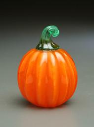 Micro Pumpkin, orange, clear cased.
