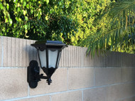 Wall mount solar light is made from cast aluminum and tempered glass lenses.