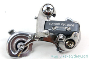 Suntour Cyclone 7000 MID CAGE Rear Derailleur: Silver Bullseye Pulleys (Near Mint+)