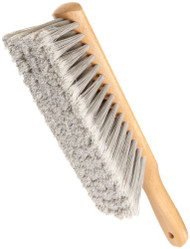 Magnolia Brush Beaver-Tail Counter Duster Model 55.  The fiber filling material is white silver Polypropylene flagged and it is staple set in clear lacquered hardwood block with hang-up hole. Brush Face length: 9 inches, Overall Length: 13 1/2 Inches.
