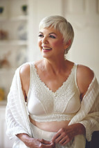 American Breast Care Embrace Mastectomy Bra in black, candle light, and soft mocha