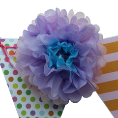 These flower pom poms look amazing on bunting.