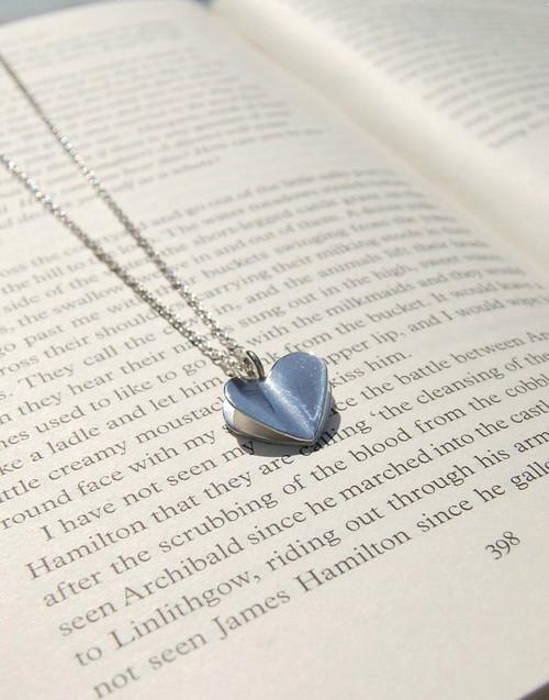 Elegant sterling silver folded heart pendant