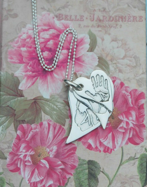 Fine silver triple stacked wavy heart pendants and sterling silver chain