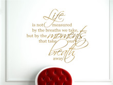 life is not measured by the breaths we take wall sayings gold
