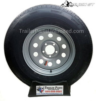 "15"" 10ply radial trailer tire mounted on a silver mod steel wheel 5x4.5"""