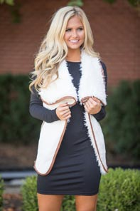 Black dress and cute fluffy vest