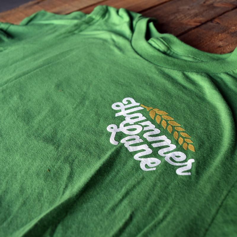 Against The Grain Hammer Lane Trucker T-Shirt Logo