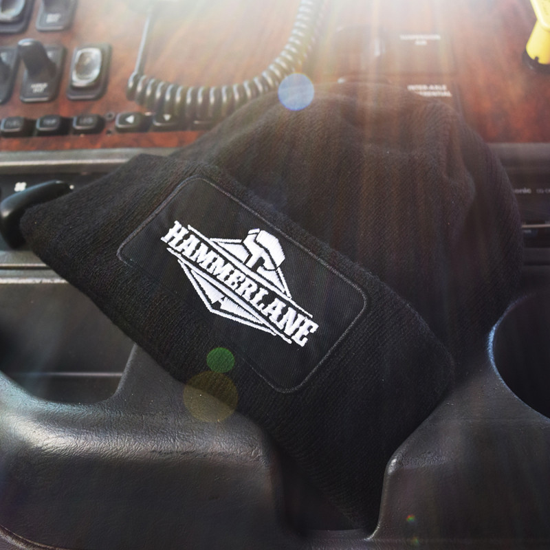 Black Hammer Lane Logo Beanie On Dashboard
