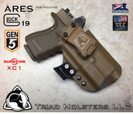 """ARES Holster shown for the Glock 19 Gen 5 equipped with a RMR, and the Surefire XC1 weapon mounted light, Right Hand Draw, in Coyote Tan, with Coyote Tan Enhanced Triad Spartan 1.5"""" Clip, Zero Cant Angle"""
