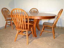 Oval Solid Birch Table With Four Arrow Back Chairs in Cherry Finish