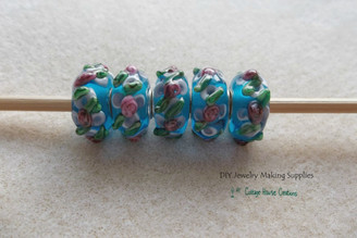 Rosettes on Blue Glass Lampwork European Big Hole Euro Bead