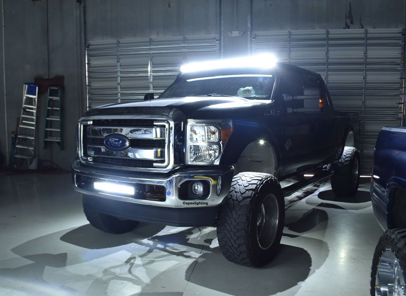A pair of ford f250s with rigid recon led lights apexlighting the black ford f250 showing off its rigid 54 rds curved light bar on the roof 20 rigid e series bar in the bumper and two rigid a series rock lights in aloadofball Images