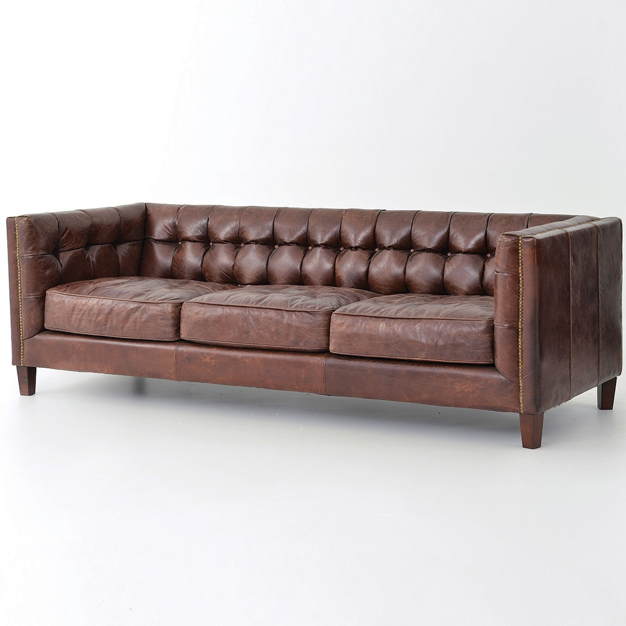 Abbott vintage cigar tufted leather sofa zin home for Industrial couch