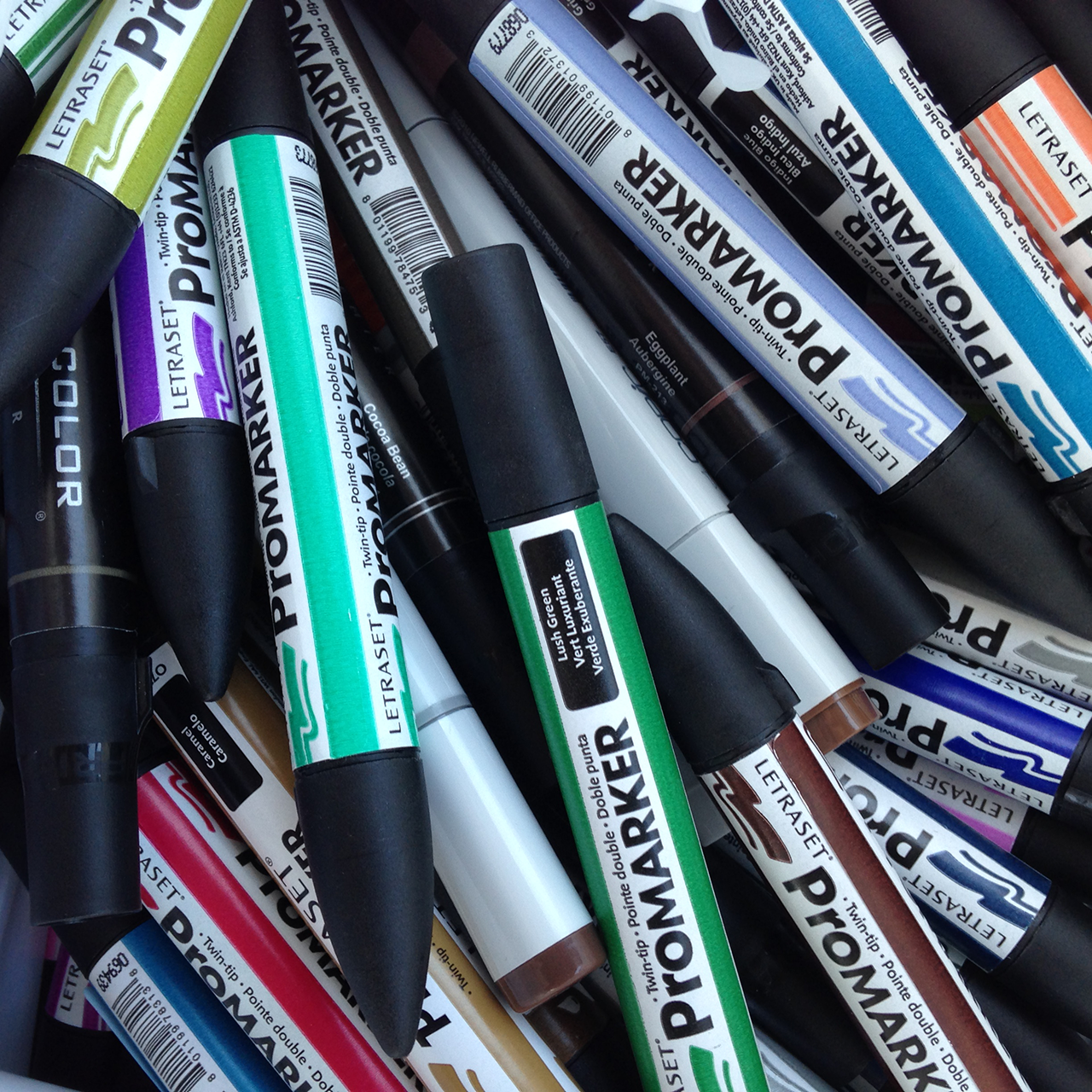A pile of ProMarkers by Letraset in a variety of colors
