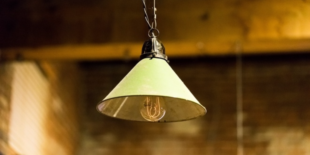 A lamp handing with a bulb visible