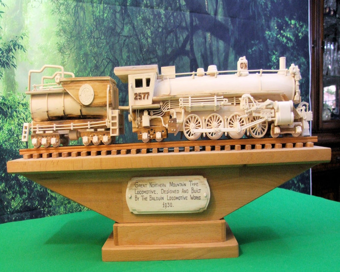 Hand Carved One of a Kind Mammoth Tusk Train Model of the Greath Northern Train