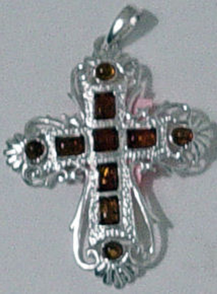 Amber cross handmade from amber stones from the baltic Sea