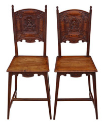 Antique pair of Continental C1900 carved walnut hall chairs