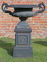 Large antique cast iron urn on plinth classical planter
